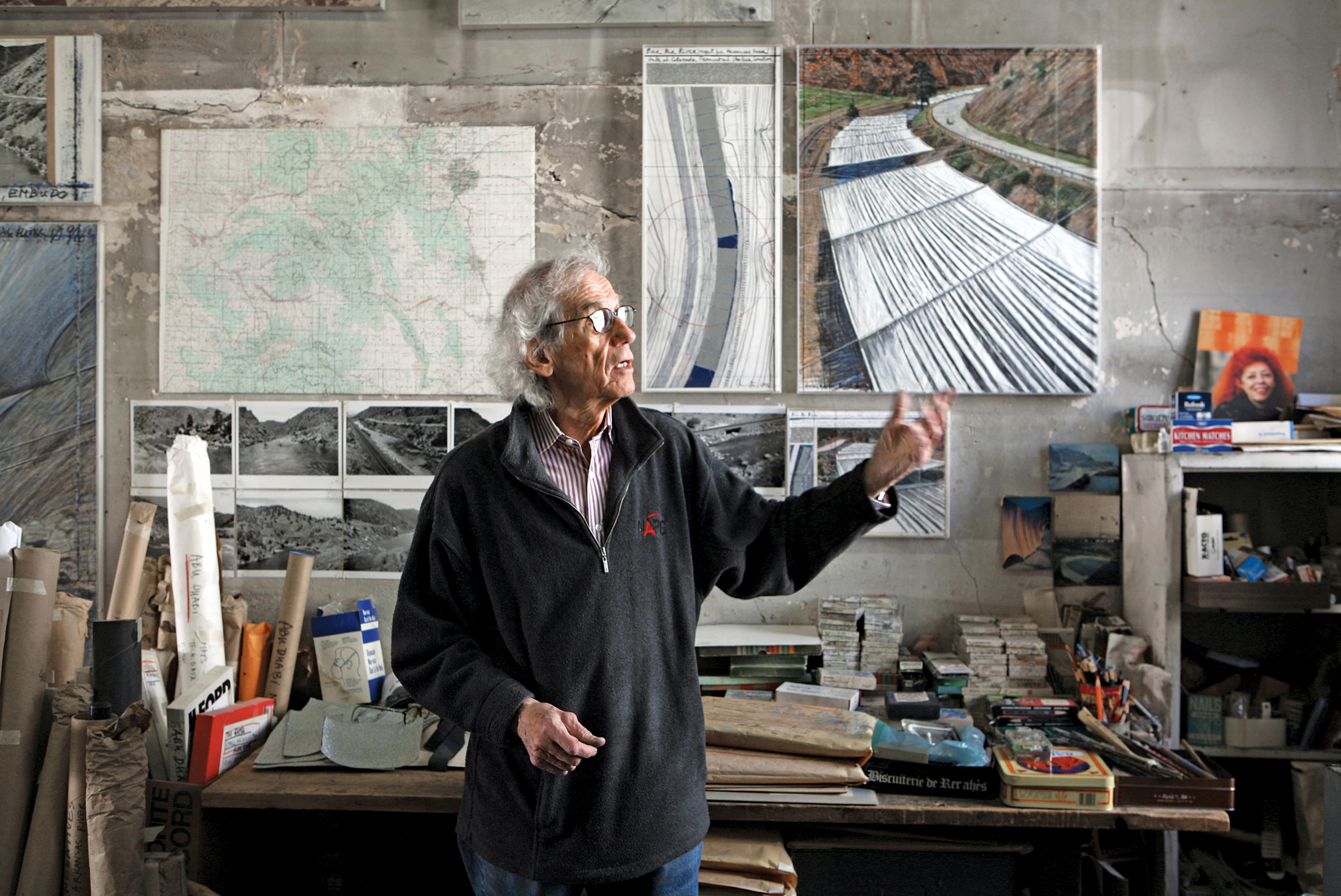 Christo in his studio with a preparatory collage for Over The River 2011 Photo: Wolfgang Volz © 2011 Christo