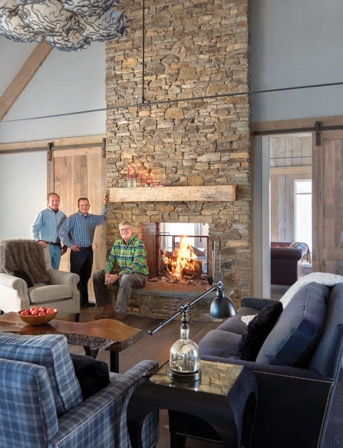 John Steel (left) president and owner of Steel Construction (builder of the Beechers' house in Stowe) joins the company's site supervisors John Hudgens (center) and Paul Kartluke at the house's floor-to-ceiling fireplace.