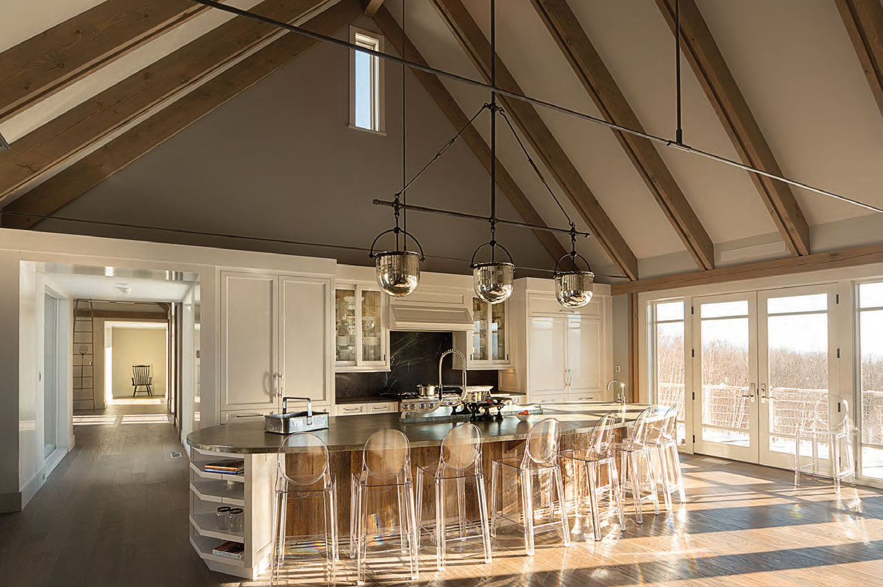 Every room and every feature (including the clear acrylic bar stools and 16-and-a-half-foot kitchen island, above) keys into at least one of the owners' goals in terms of both style and practicality...and also keeps nonessential elements in the background.
