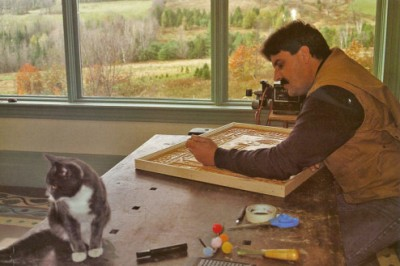 Stephen working on a woodcut in his home studio.