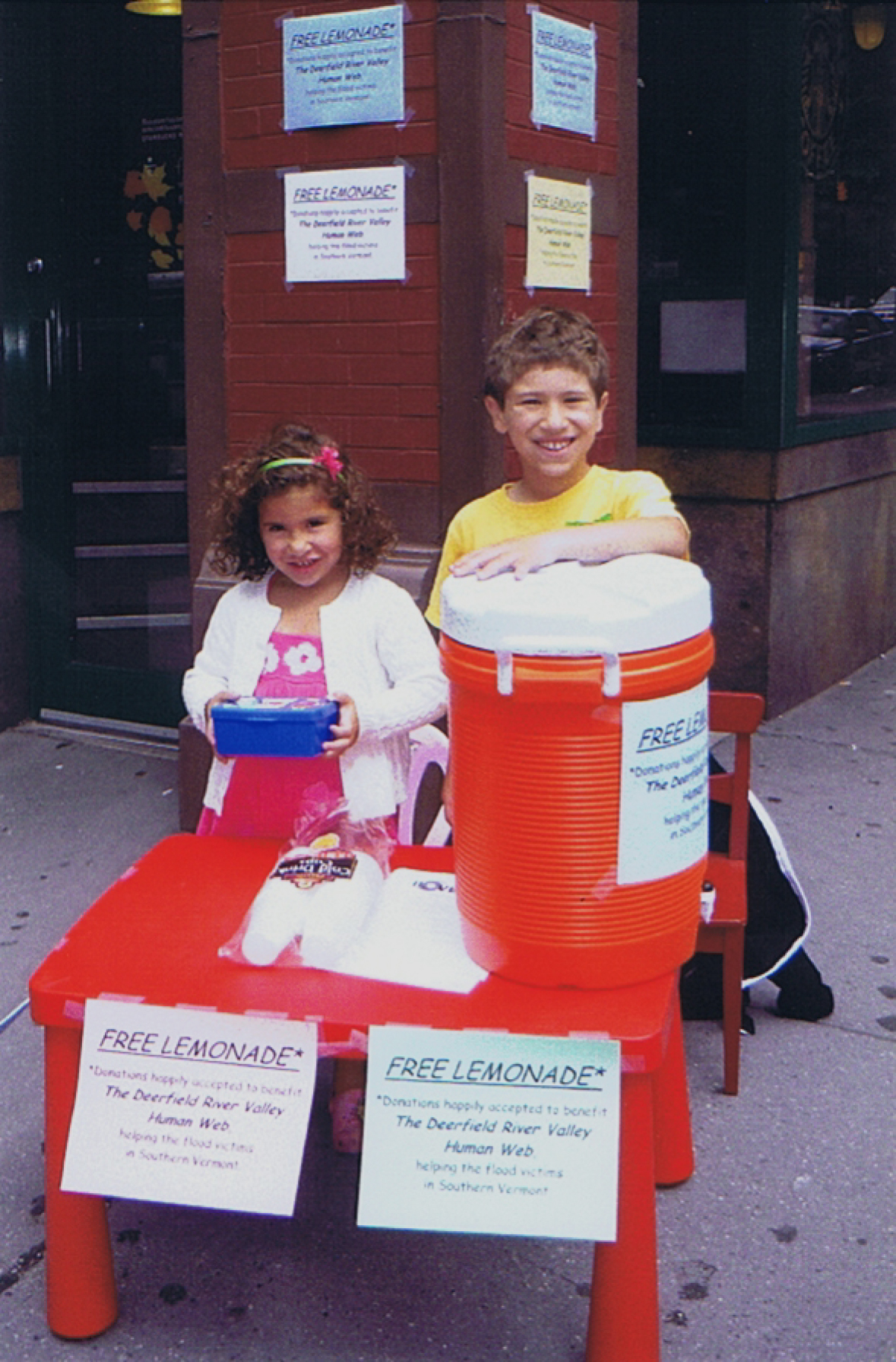 Kids donating lemonade profits to flood recovery