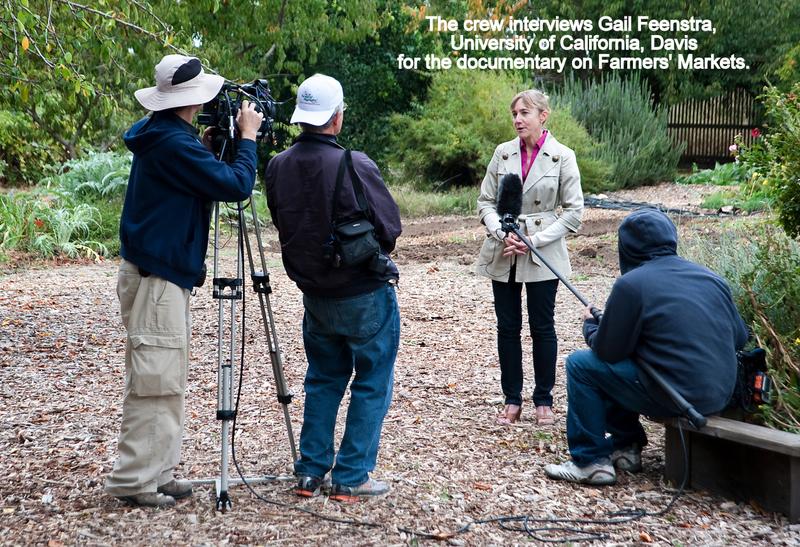 The crew interviews Gail Feenestra, University of California, Davis for the documentary on Farmers' Markets.