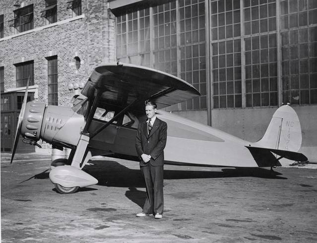 """Spencer Kellogg II in front of his Fairchild with a Warner """"45"""" engine, NC14793"""