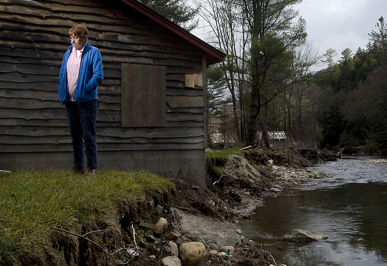 Dotty Casciotta, 80, of Stockbridge, stands outside of her destroyed A-frame home in Chalet Village on Wednesday Nov. 10, 2011. The Tweed River broke its banks during Tropical Storm Irene and flooded the riverside neighborhood. / EMILY McMANAMY, Free Press