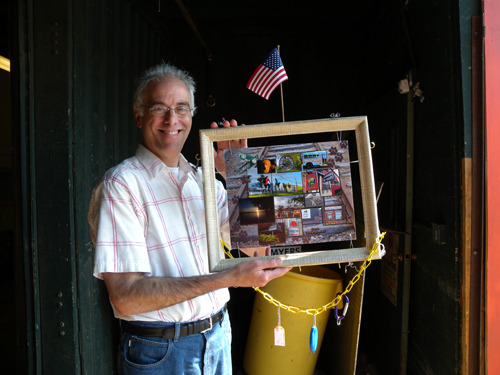 Roy Feldman, head of SEABA Burlington poses with completed image donated for the silent auction tonight at the annual party. Big Picture Frame helped with the final design.